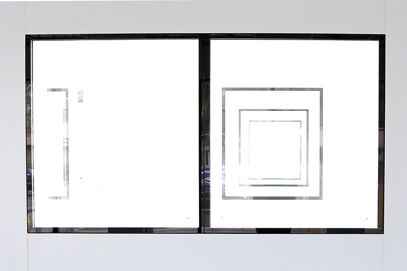 An array of windows from the outside perspective of Eagle's cleanroom suites