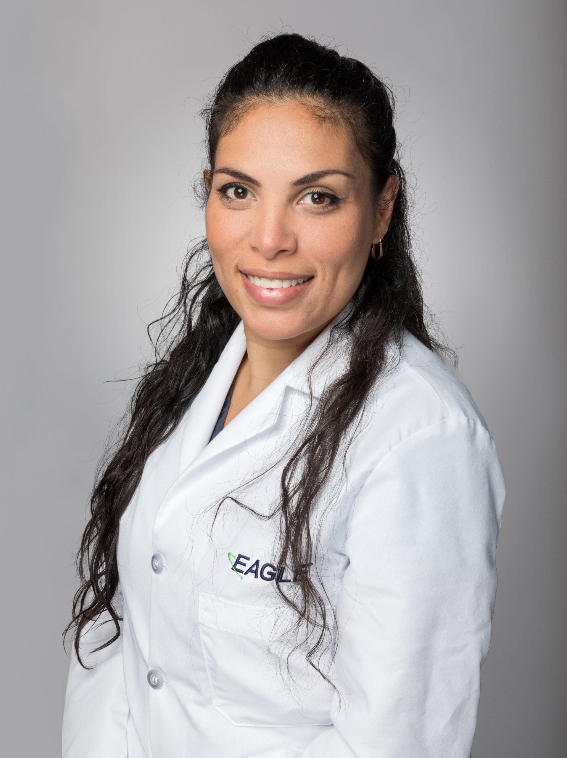 Chemist Supervisor Margaret Pereira smiles while wearing an Eagle lab coat.